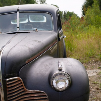 a black antique abandoned car