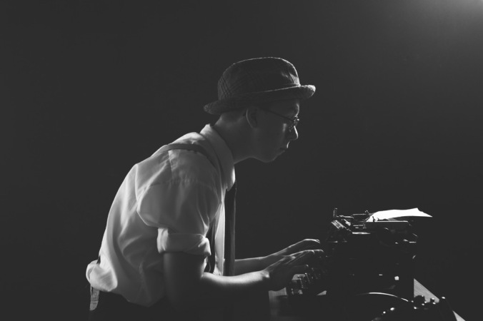 Retro image of a journalist using a typewriter